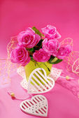 Bunch of roses on pink background  — Stock Photo