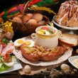 Easter traditional dishes on rural wooden table — Stock Photo #65397595