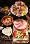 Easter traditional dishes on rural wooden table — Stock Photo