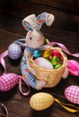 Easter decoration with bunny holding basket and eggs — Stock Photo