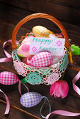 Easter wicker basket with eggs and greeting card — Stock Photo