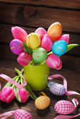 Bunch of pink tulips and colorful easter eggs — Stock Photo
