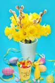 Easter decoration with egg shaped candies in bucket and rabbit f — Stock Photo