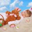 Sleeping baby in easter bunny costume — Stock Photo #66810175