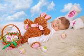 Sleeping baby in easter bunny costume — Stock Photo