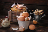 Rustic still life with eggs in vintage wooden bucket for easter — Stock Photo