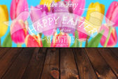 Easter card with colorful tulips and greetings on wooden backgro — Stock Photo