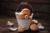 Rustic still life of eggs with written easter greetings in vinta — Stock Photo