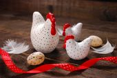Easter decoration with three white hens on wooden background  — Stock Photo
