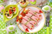 Rolled ham stuffed with cheese and vegetables for easter breakfa — Stock Photo