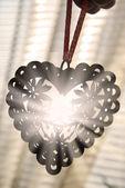 Openwork heart with sunlight rays — Stock Photo