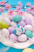 Easter eggs in white plate — Stock Photo