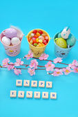 Easter background with greetings and eggs in buckets — Stock Photo