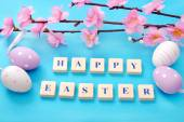 Easter background with greetings and blooming tree branch — Stock Photo