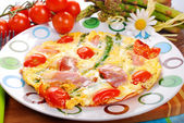 Frittata omelet with asparagus,tomato and ham — Stock Photo