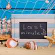 Marine frame with last minute offer written on  blackboard — 图库照片 #71418261
