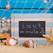 Marine frame with last minute offer written on  blackboard — Stockfoto #71418261
