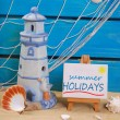 Seaside summer holidays still life with text written on easel — Stock Photo #71418405
