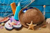 Sun protection still life on the beach — Stock Photo