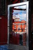 Reflection of old building in glass door on Off Piotrkowska in L — Stock Photo