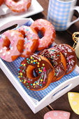 Homemade donuts with chocolate and icing glaze — Stock Photo