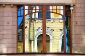 Reflection of old building in window in Lodz — Stock Photo