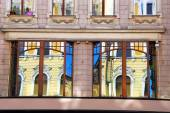Reflections of old building in windows in Lodz — Stock Photo