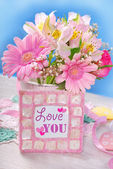Bunch of beautiful pink flowers and frame with text — Stok fotoğraf