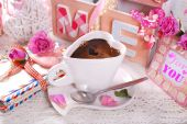 Cup of coffee and old love letters in romantic scenery — Stock Photo