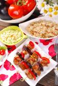 Meat and vegetable skewers with teriyaki sauce for lunch — Stock Photo