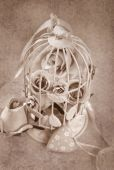 Vintage style roses in metal cage — Stock Photo