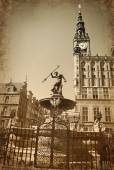 Vintage style photo of Neptune fountain  in Gdansk — Stock Photo