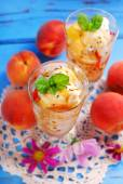 Peach and vanilla ice cream with caramel and mint — Stock Photo
