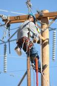 Electrical lineman working on lines — Stock Photo