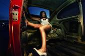 Woman in stripped out car — Stock Photo