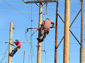 Two electrical linemen working — Stock Photo