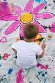Young boy painting on canvas — Stock Photo