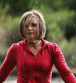 Girl caught in rain shower — Stock Photo