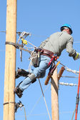 Electrical lineman student working on pole — Stock Photo