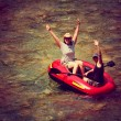 Two girls floating in inflatable raft — Stock Photo #53607917