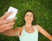 Cute girl taking a selfie — Stock Photo