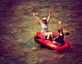 Two girls floating in inflatable raft — Stock Photo