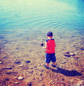 Boy trying to catch fish — Foto de Stock
