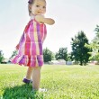Cute girl running in a local park — Stock Photo #53619167