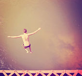 Boy jumping into river — Stock Photo