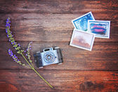 Vintage photo camera on wooden table — Photo