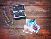 Vintage photo camera on wooden table — Stock Photo