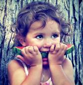 Cute girl eating watermelon — Stock Photo