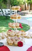 Tabe full of cupcakes — Zdjęcie stockowe
