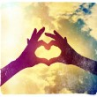 Two hands making heart shape in sky — Stock Photo #53620929